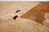 A grain cart waits for a combine on a prairie lentil field