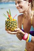 young happy woman with pineapple cocktail in exotic destination poster