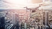 multicopter drone with package flying over the city of Frankfurt am Main, Germany poster
