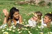 Happy Smiling Youth Reading Outdoors poster