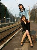 Young Girls Waiting For The Train