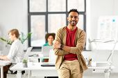 business and people concept - happy smiling indian man with smart watch at office poster