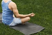 Young Man Practicing Yoga, Meditation Exercises. Unrecognizable Guy Does Lotus Pose For Relaxation,  poster