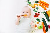 Healthy Child Nutrition, Food Background, Top View. Baby 8 Months Old Surrounded With Different Fres poster