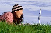 Happy Smiling Young Woman With Laptop Outdoors poster