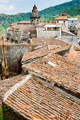 View On Ancient Tile Roofs And Church Tower In Sicilian Town