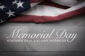 The Flag Of The United Sates Of America On A Grey Plank Background With Memorial Day poster