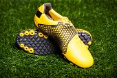 Pair of soccer shoes on grass field