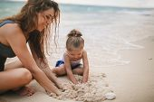 Childrens Day. Mom And Baby Playing Near Beach. poster