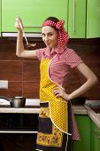 Beautiful happy woman in kitchen interior cooking