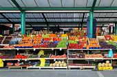 picture of fruits vegetables  - Fresh organic fruits at farmers market stall - JPG