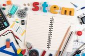 Stem Education. Science Technology Engineering Mathematics. Stem Word On Book With Education Equipme poster