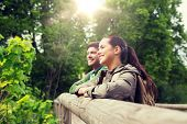 travel, hiking, backpacking, tourism and people concept - smiling couple with backpacks in nature poster