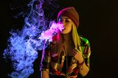 Vaping Girl. Young Hipster Woman Vape E-cig On Studio On Black Background. Hip-hop Style. Close Up.  poster