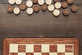 Wooden Draughts Game On Brown Table Background poster