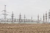 Photo Of Power Plant. Power Plant With Electric Towers In Spring. Landscape Photo With Power Plant.  poster