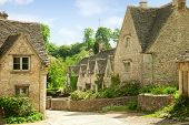 Traditional Cotswold cottages in England, UK. spring. Bibury is a village and civil parish in Glouce