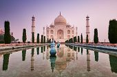 Taj Mahal Front View With Reflection In Water. Blue Hour Sunrise Shot Of Taj Mahal. Architecture Of poster