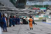 SEPANG - JUNE 10: Pit crew at work on race day at the 2012 Autobacs SUPER GT Series Round 3 on June