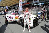 SEPANG - JUNE 10: Driver Katsumasa Chiyo poses with his Nissan GT-R Nismo GT3 car from the NDDP Raci