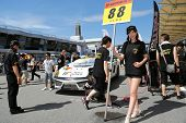 SEPANG - JUNE 10: A grid girl poses in front of a MonePa Lamborghini Gallardo car of JLOC Team at th