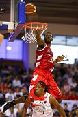 KUALA LUMPUR - JUNE 02: Vincent Crews (Beermen) jumps above Tiras Wade (Dragons) to block his lay up