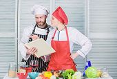 Woman Chef And Man Cooking Food Together. Culinary Family Concept. Couple In Love Cooking Healthy Re poster
