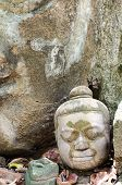 Ancient Head Buddha statue in Wat Umong at Chiangmai province, Thailand. (Made between 1400-1550 AD.
