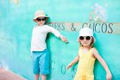 Adorable kids against colorful wall in Turks and Caicos