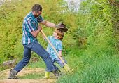 Cute Child In Nature Having Fun Cowboy Dad. Find Treasures. Little Boy And Father With Shovel Lookin poster