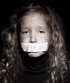 picture of begging  - Little child with taped mouth - JPG