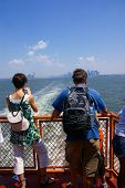 Sightseers, Tourists On Front Of .Staten Island Ferry