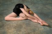 Young Woman Doing Ballet Stretch