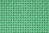picture of aida  - Closeup image of woven green aida cloth used for cross stitch - JPG