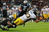 INNSBRUCK, VIENNA - JUNE 18: WR Danilo Naranjo Gonzalez (#23 Adler) is tackled by WR Talib Wise (#4