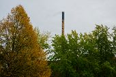 Odense, Denmark: The Chimney Outside The Building Is Painted With Flowers, Like A Giraffes Neck. poster