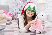 Toy Never Sleeps. Little Girl Play With Toy Bunny. Happy Child Got Toy Gift From Santa. Christmas Gi poster