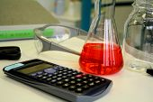 Red Liquid In Beaker On The Table In The Laboratory