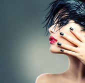 Fashion Art Model Girl Portrait. Punk Style Woman. Black Hair and Nails.