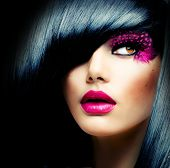 Fashion Brunette Model Portrait. Hairstyle. Haircut. Professional Makeup. False Eyelashes. Purple Ma