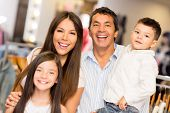Portrait of happy family in a clothing store smiling