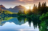 image of morning sunrise  - Mountain lake in National Park High Tatra - JPG
