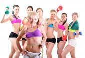 Group of fitness girls holding measuring tape, dumbbells, scales and boxing gloves. Portrait of spor