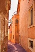 Roussillon Village, Urban Street And Red Facades . Luberon, Provence,