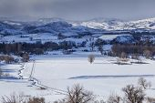 stock photo of collins  - winter storm casting a shadow on a valley in Rocky Mountains  - JPG