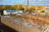 Industrial warehouse - huge heaps with pulpwood ready for transportation