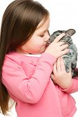 Portrait of a little girl with chinchilla, isolated over white