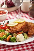 Viener schnitzel, breaded steak with broccoli, cauliflower and carrot