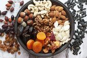 stock photo of apricot  - Variety of 12 assorted nuts and dried fruits - JPG