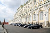 MOSCOW - APRIL 24: Government cars with lights flashing are near Grand Kremlin Palace on April 24, 2